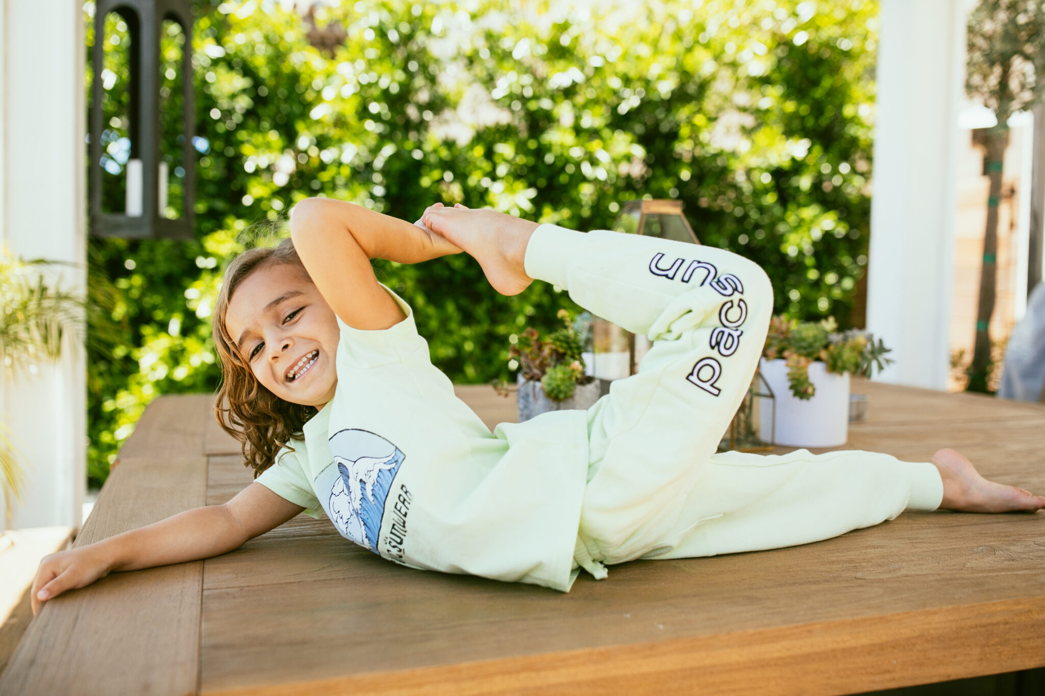 boy stretching on table