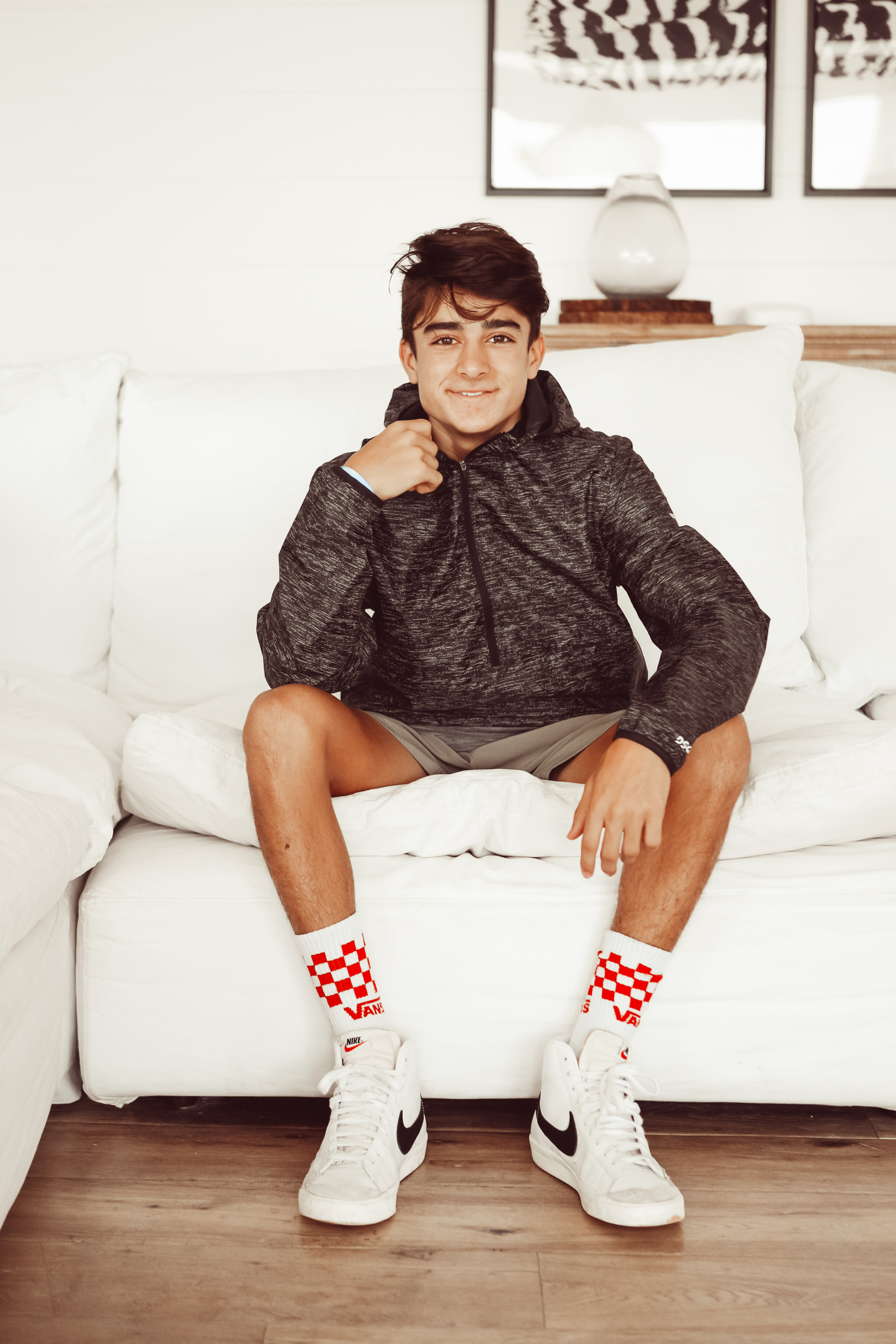 teen sitting on couch