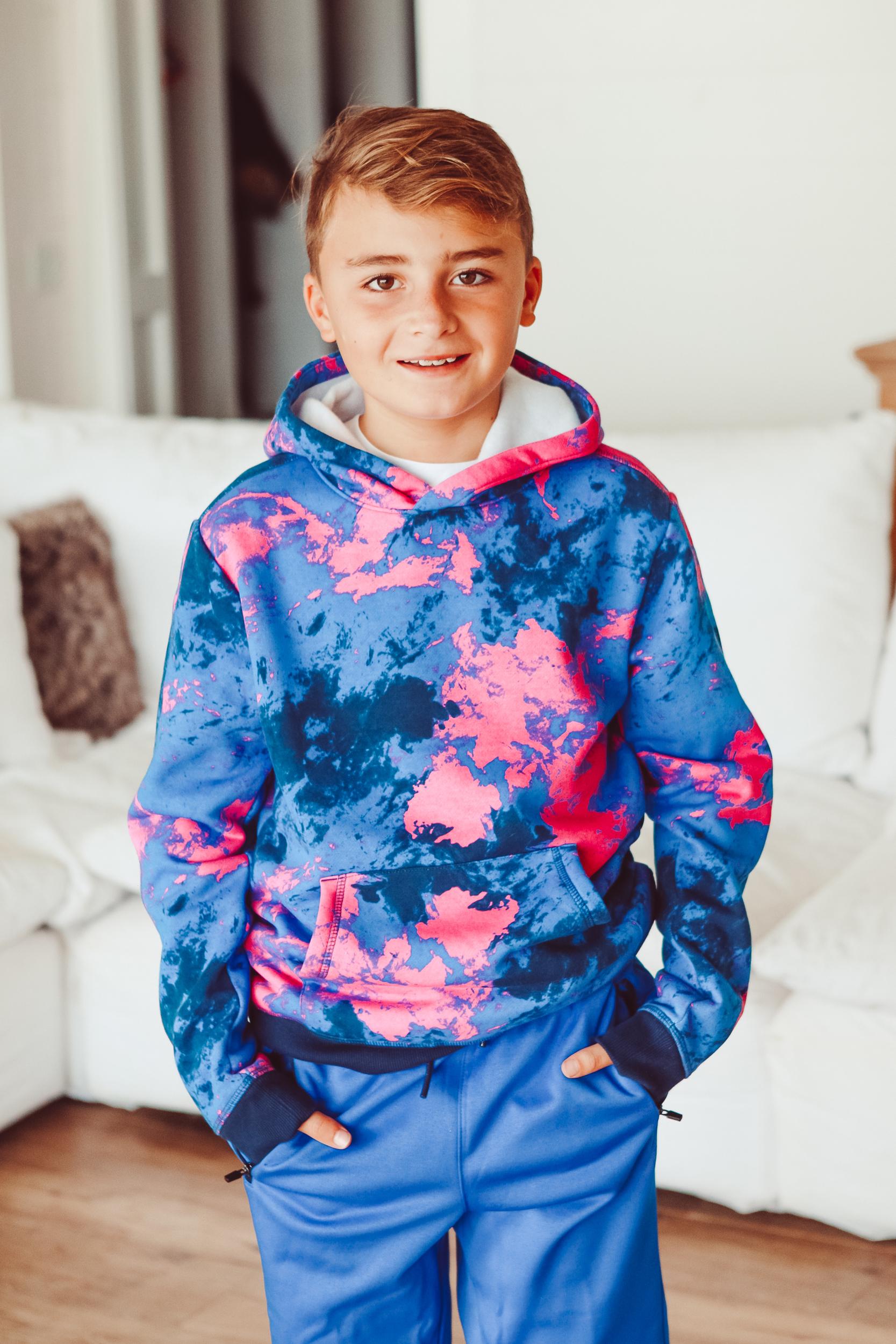 boy in bright sweatshirt