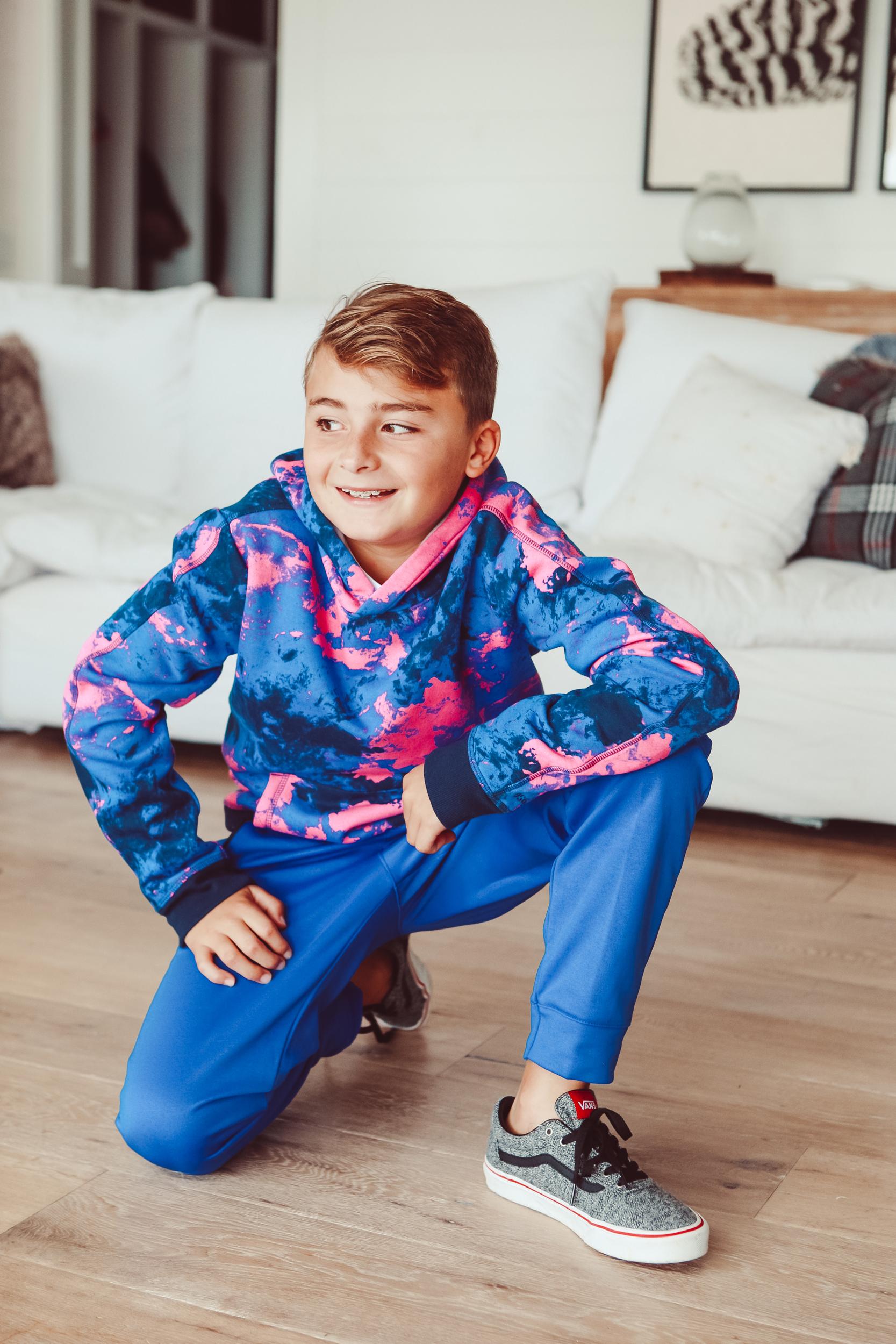 boy kneeling on floor