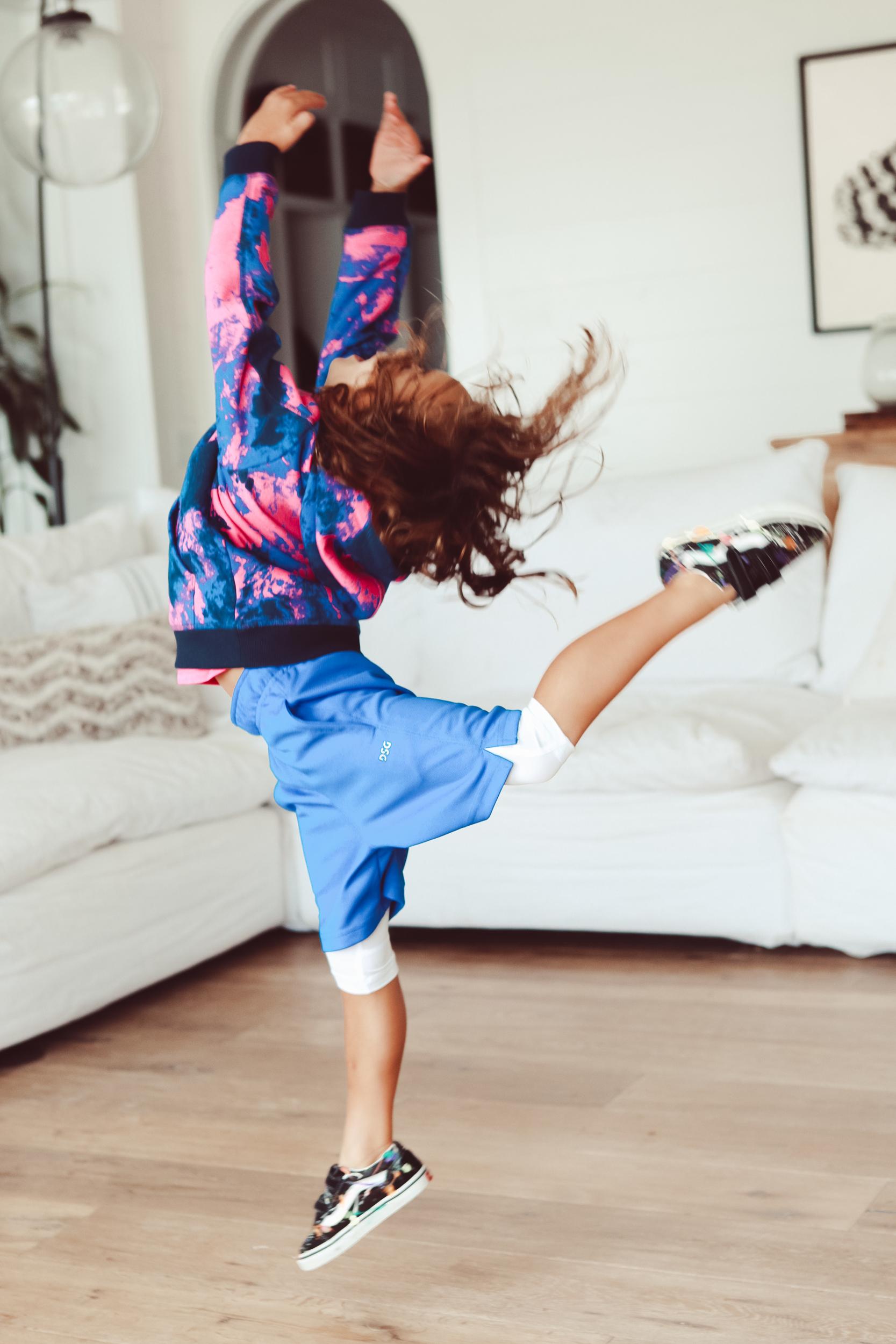 kid dancing in living room