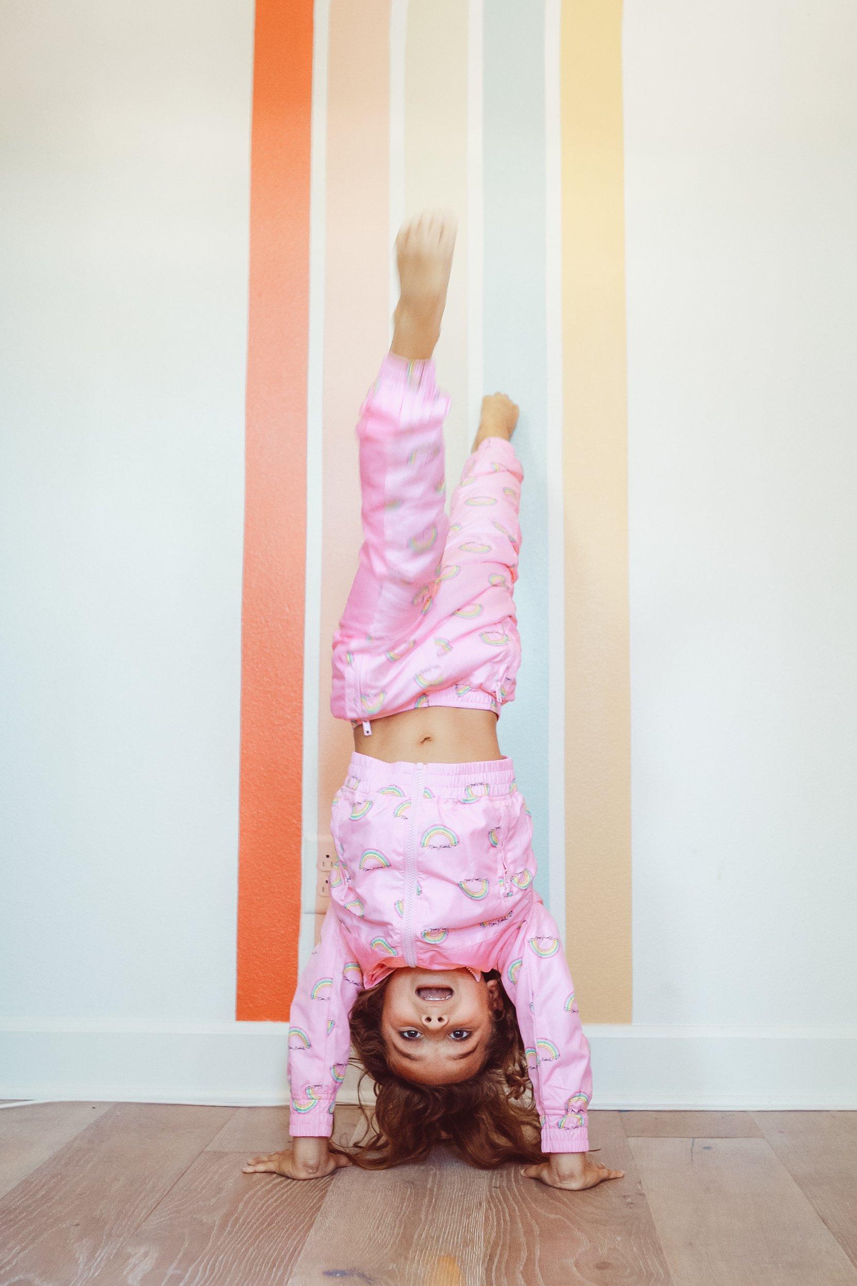 kid doing a handstand