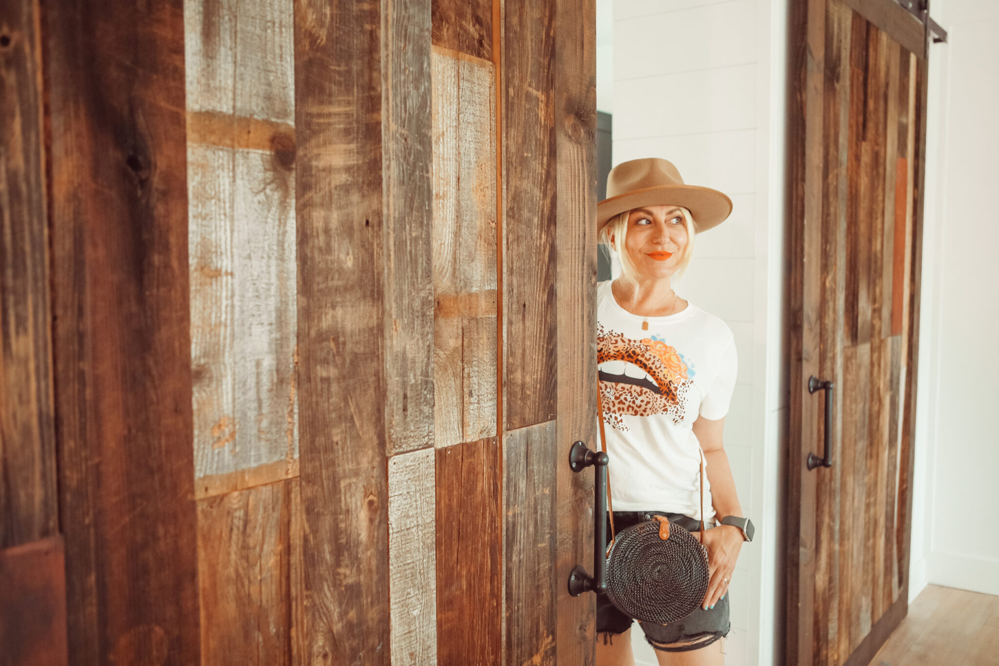 woman looking from behind door