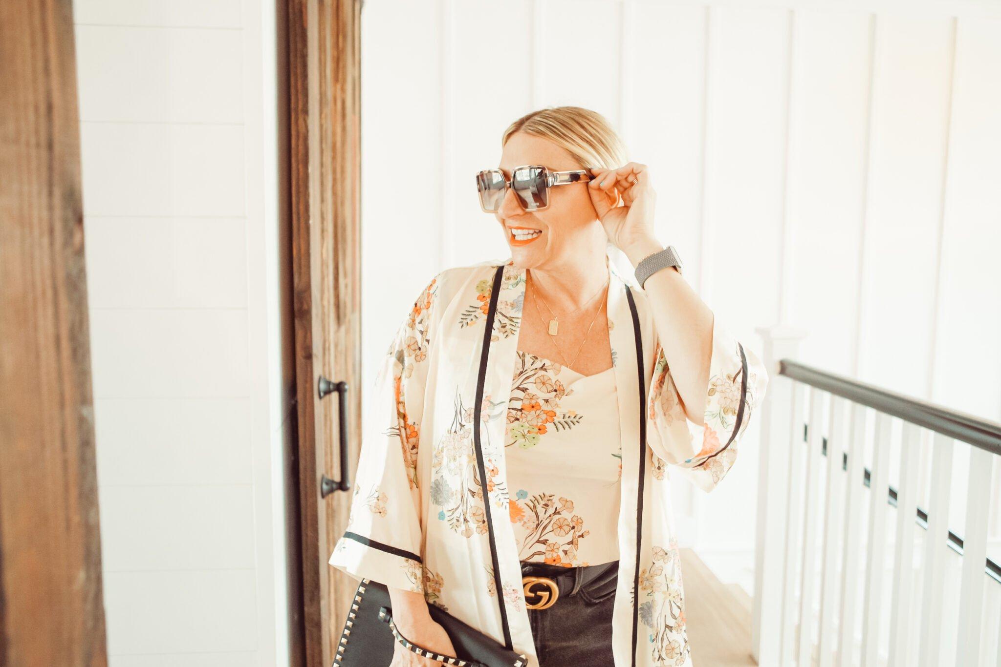 woman taking off sunglasses