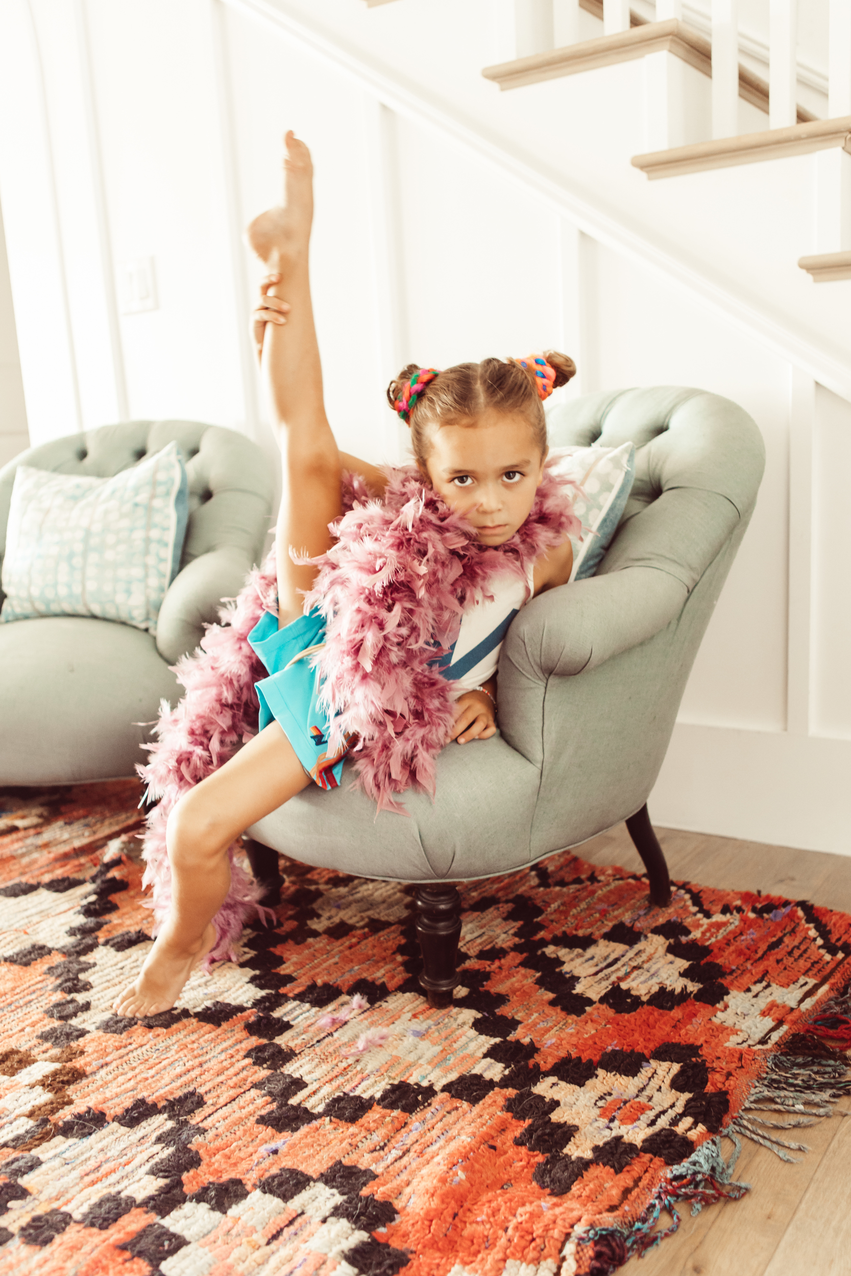 boy dancing on chair