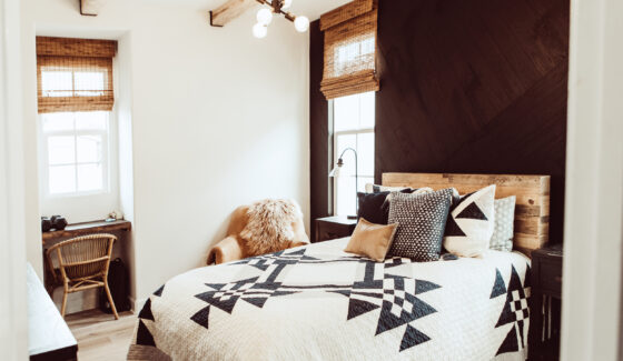 bedroom with stikwood wall feature